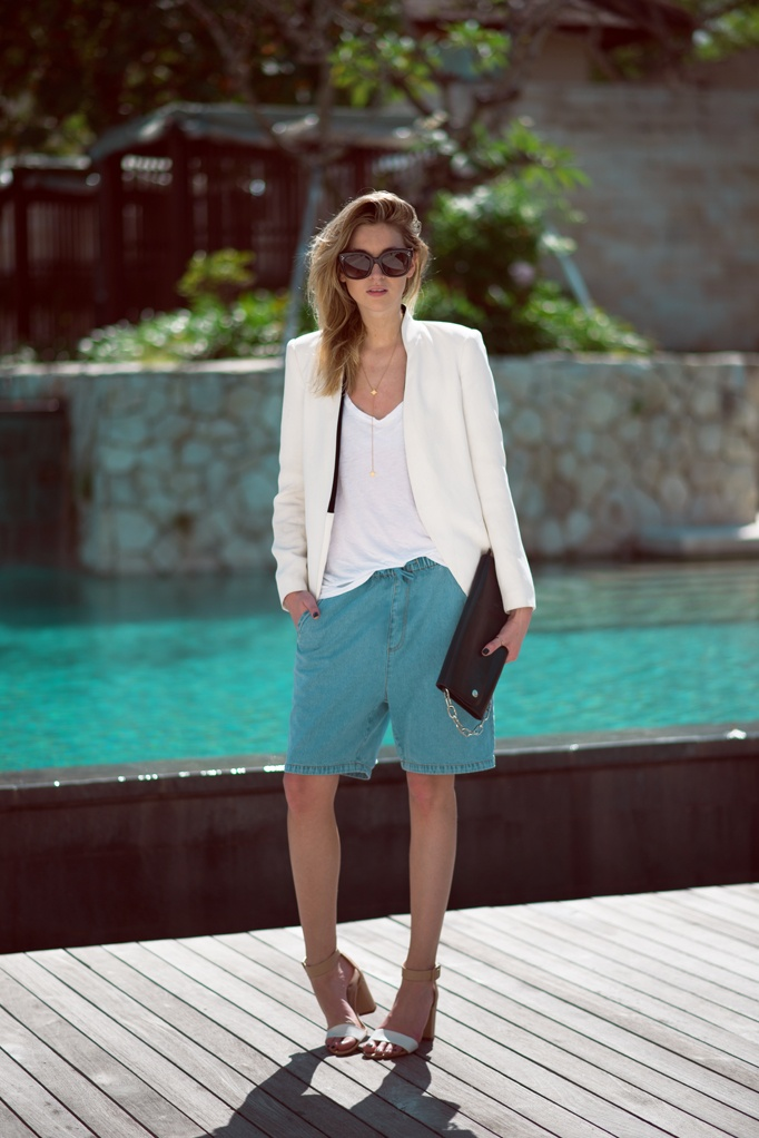 A more casual way to don a blazer to a Bermuda shorts outfit is by wearing pieces in summer colors like white, blue, and yellow.