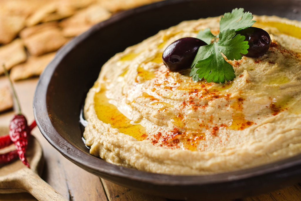 Hummus or houmous is a Levantine food dip or spread made from cooked ...
