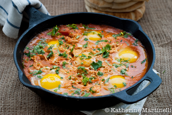 Shakshouka or shakshuka is a dish of eggs poached in a sauce of tomatoes, chili peppers, and onions, often spiced with cumin. It is believed to have a Tunisian origin